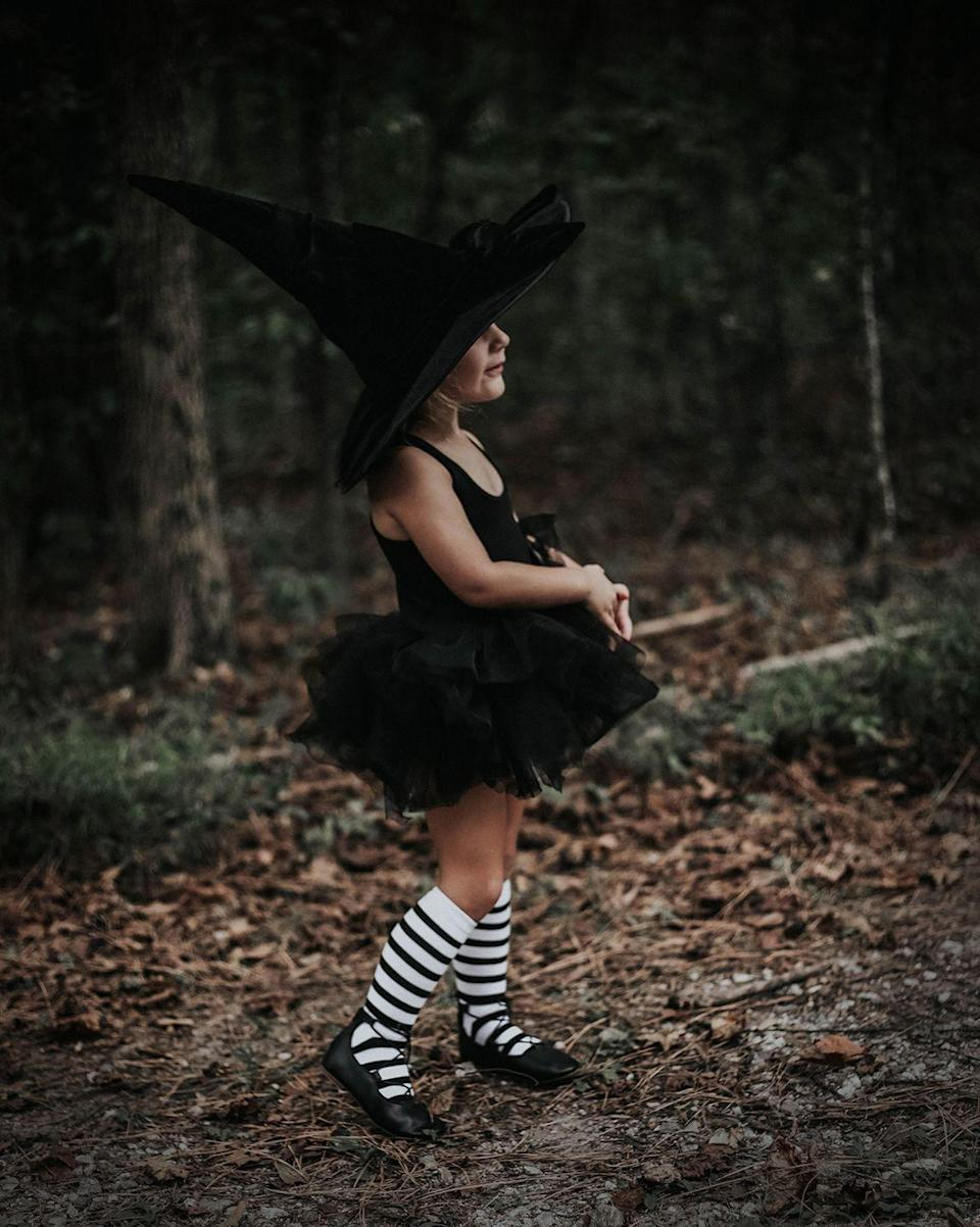 """<p>Who says a witch costume can't be pretty? A pair of striped socks and a spooky hat are all you need to transform a simple tutu and leotard. </p><p><strong>Get the tutorial at <a href=""""https://chanelmovingforward.com/2018/09/baddest-witch-in-the-west-halloween-costume.html"""" rel=""""nofollow noopener"""" target=""""_blank"""" data-ylk=""""slk:Chanel Moving Forward"""" class=""""link rapid-noclick-resp"""">Chanel Moving Forward</a>. </strong> </p><p><strong><a class=""""link rapid-noclick-resp"""" href=""""https://www.amazon.com/OULII-Girls-Striped-Stockings-Year-old/dp/B076ZL2RR5/ref=sr_1_5?tag=syn-yahoo-20&ascsubtag=%5Bartid%7C10050.g.28304812%5Bsrc%7Cyahoo-us"""" rel=""""nofollow noopener"""" target=""""_blank"""" data-ylk=""""slk:SHOP STRIPED SOCKS"""">SHOP STRIPED SOCKS</a></strong> </p>"""