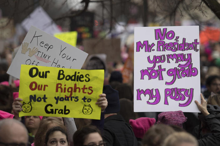 <p>Demonstrators carry placards as they march on Independence Avenue during the Women's March on Washington in Washington, DC, January 21, 2017. (JIM WATSON/AFP/Getty Images) </p>