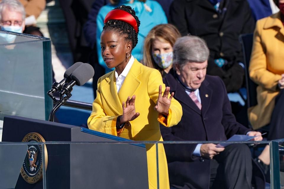 <p>The poet and activist wore a full head of embellished twists swept up and adorned with a bright red Prada hairband to speak at the inauguration of President Joe Biden.</p>