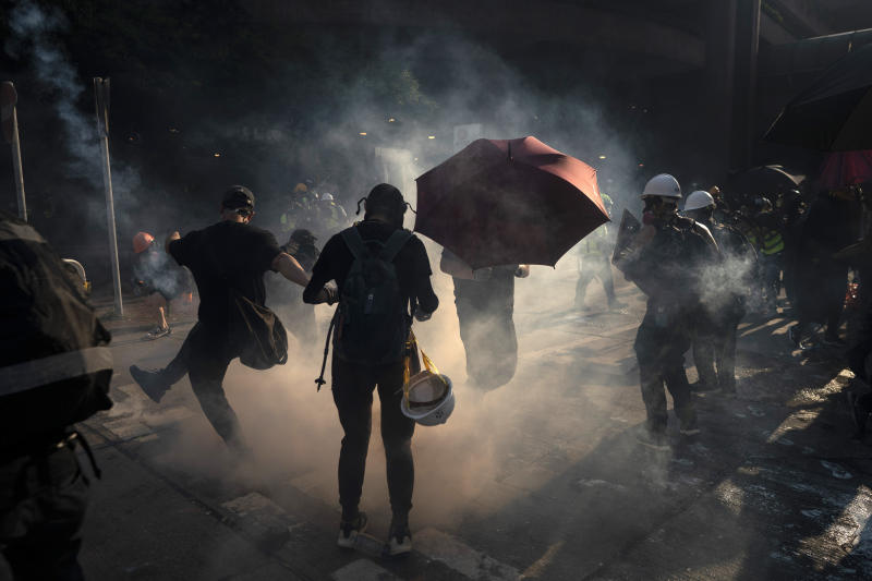 A protestor kicks back an exploded tear gas shell in Hong Kong, Oct. 1, 2019. (Photo: Felipe Dana/AP)