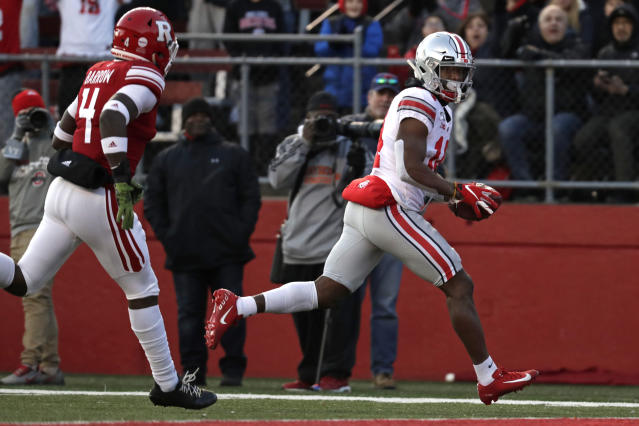 Ohio State wide receiver K.J. Hill scores a touchdown in front of Rutgers defensive back Tre Avery (4) during the first half of an NCAA college football game Saturday, Nov. 16, 2019, in Piscataway, N.J. Ohio State won 56-21. (AP Photo/Adam Hunger)