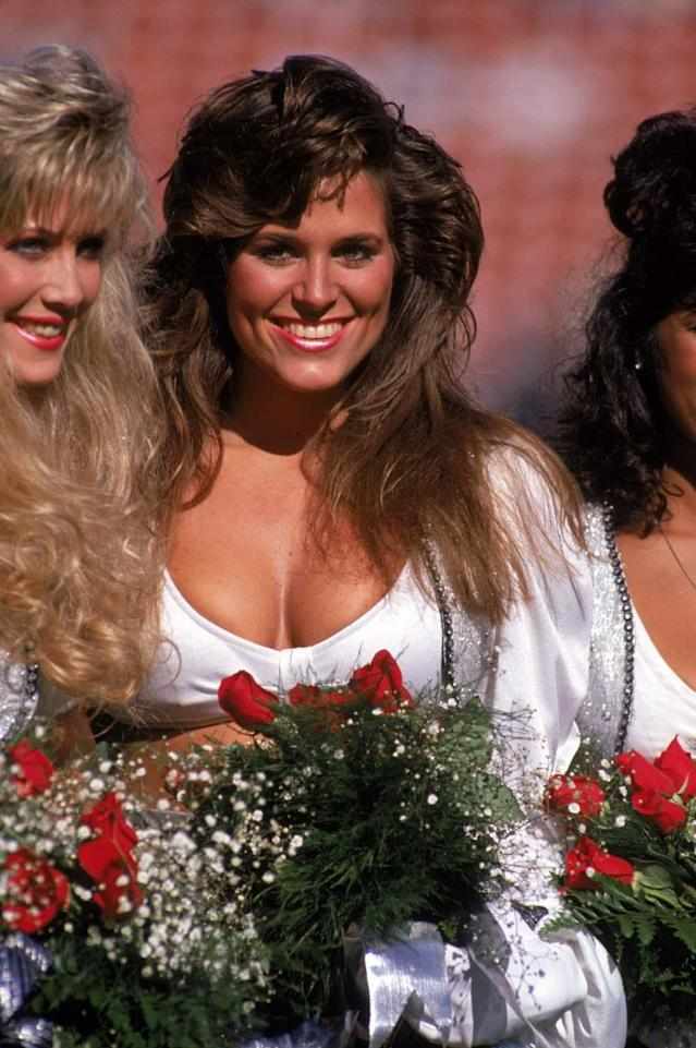 LOS ANGELES - NOVEMBER 26: The Raiderettes cheerleaders looks on during a game between the New England Patriots and the Los Angeles Raiders at the Los Angeles Memorial Coliseum on November 26, 1989 in Los Angeles, California. The Raiders won 24-21. (Photo by George Rose/Getty Images)