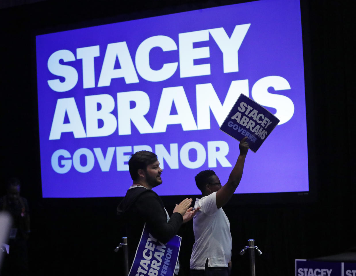 Supporters react during an election-night watch party for Georgia Democratic gubernatorial candidate Stacey Abrams, Tuesday, May 22, 2018, in Atlanta. (AP Photo/John Bazemore)