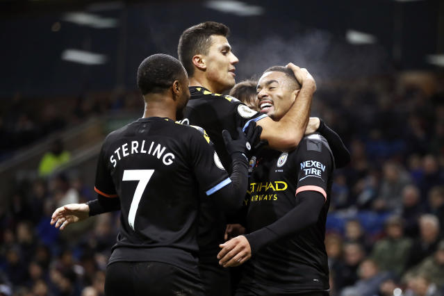 Manchester City's Gabriel Jesus, right, celebrates scoring his sides first goal of the game against Burnley, with teammates during their Premier League soccer match at Turf Moor in Burnley, England, Tuesday Dec. 3, 2019. (Martin Rickett/PA via AP)