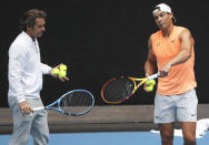 Spain's Rafael Nadal talks with coach Francis Roig, left, during a practice session ahead of the Australian Open in Melbourne, Australia, Sunday, Feb. 7, 2021.(AP Photo/Hamish Blair)