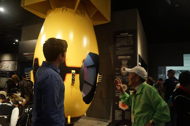 Takashi Kado, 82, a survivor of the atomic bombing of Nagasaki, talks to Yahoo News journalist Michael Walsh about nuclear weapons while looking at a replica of Fat Man, the bomb detonated over Nagasaki in August 1945. (Photo: Michael Walsh/Yahoo News)