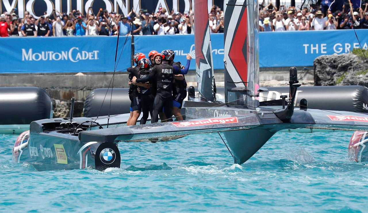 Sailing - America's Cup finals - Hamilton, Bermuda - June 26, 2017 -  Emirates Team New Zealand celebrate after crossing the finish line to defeat Oracle Team USA in race nine and win the America's Cup. REUTERS/Mike Segar