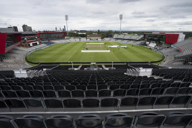 FILE - In this Tuesday, Sept. 3, 2019 file photo, a view of the stadium during a nets session before the 4th Ashes Test cricket match between England and Australia at Old Trafford cricket ground in Manchester, England. The Old Trafford cricket ground is spearheading plans in England to try to bring fans back into a sports venue during the coronavirus pandemic. Lancashire Cricket Club chief executive Daniel Gidney believes social distancing can be applied in their 26,000-seat ground to allow in at least 1,000 fans. (AP Photo/Jon Super, File)