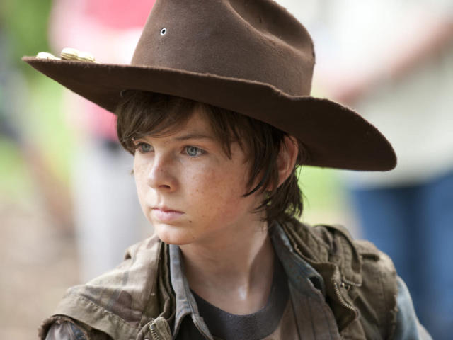 "Carl Grimes (Chandler Riggs) in ""Seed,"" the Season Three premiere episode of ""The Walking Dead"" on AMC."