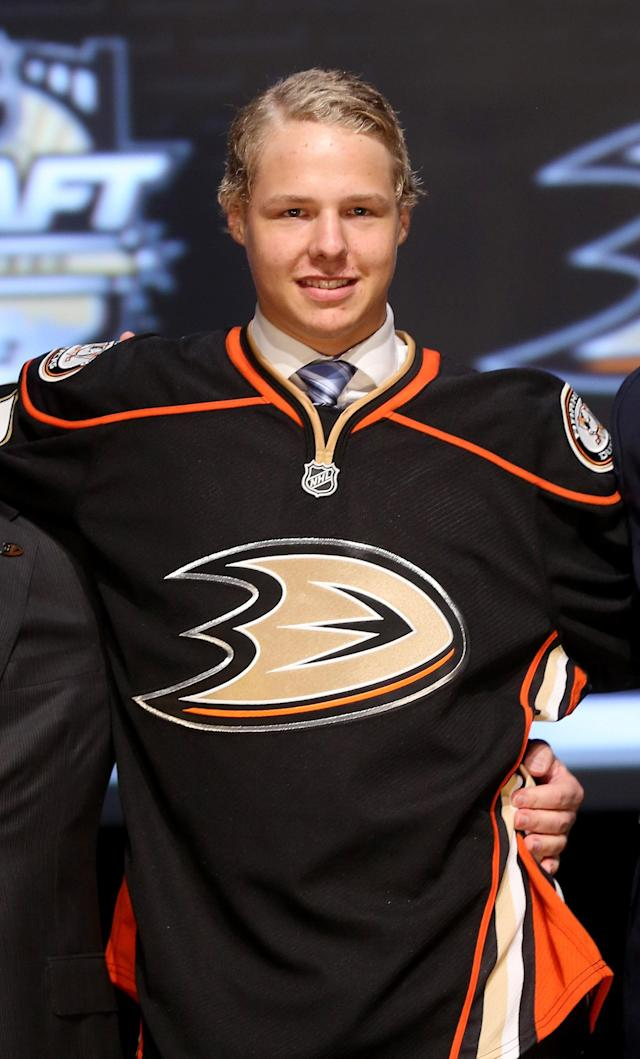 PITTSBURGH, PA - JUNE 22: Hampus Lindholm, sixth overall pick by the Anaheim Ducks, poses on stage during Round One of the 2012 NHL Entry Draft at Consol Energy Center on June 22, 2012 in Pittsburgh, Pennsylvania. (Photo by Bruce Bennett/Getty Images)