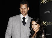 FILE - In this Aug. 17, 2011 file photo, reality TV personality Kim Kardashian, right, and her fiance, NBA basketball player Kris Humphries, arrive at the Kardashian Kollection launch party in Los Angeles. Humphries and Kardashian were married for 72-days and their divorce dragged on far longer than the marriage, threatening to keep her legally tethered to Humphries at the birth of her first child, with Kanye West. (AP Photo/Matt Sayles, File)