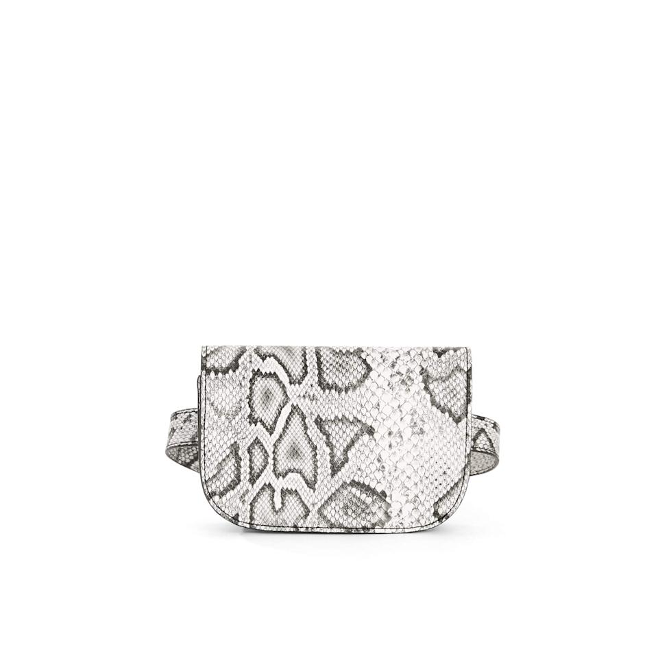 "<p>This <a href=""https://www.popsugar.com/buy/Scoop-Faux-Snake-Belt-Bag-491256?p_name=Scoop%20Faux-Snake%20Belt%20Bag&retailer=walmart.com&pid=491256&price=20&evar1=tres%3Aus&evar9=46684704&evar98=https%3A%2F%2Fwww.popsugar.com%2Fphoto-gallery%2F46684704%2Fimage%2F46684706%2FScoop-Faux-Snake-Belt-Bag&list1=shopping%2Cgifts%2Cgift%20guide%2Cwalmart%2Cgifts%20for%20her%2Cgifts%20for%20women&prop13=api&pdata=1"" rel=""nofollow"" data-shoppable-link=""1"" target=""_blank"" class=""ga-track"" data-ga-category=""Related"" data-ga-label=""https://www.walmart.com/ip/Scoop-Faux-Snake-Belt-Bag/199975465"" data-ga-action=""In-Line Links"">Scoop Faux-Snake Belt Bag</a> ($20) is so on trend.</p>"