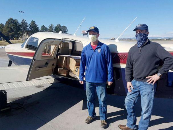 PHOTO: Pilot Erick Ecklund, left, volunteers his time during a leave of absence from United Airlines to deliver masks and face shields produced by the Make4Covid grassroots network to help respond to COVID-19. (Karen Corliss)