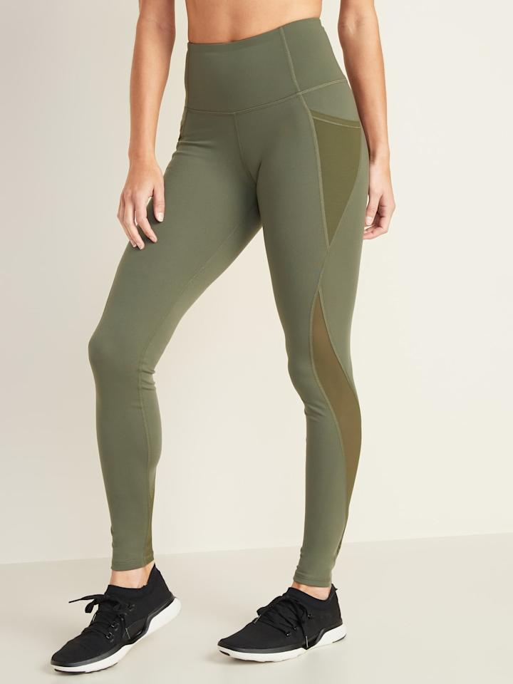 """<p>Get sweaty in these <a href=""""https://www.popsugar.com/buy/Old-Navy-High-Waisted-Elevate-Side-Pocket-Mesh-Trim-Compression-Leggings-553214?p_name=Old%20Navy%20High-Waisted%20Elevate%20Side-Pocket%20Mesh-Trim%20Compression%20Leggings&retailer=oldnavy.gap.com&pid=553214&price=20&evar1=fit%3Auk&evar9=45713544&evar98=https%3A%2F%2Fwww.popsugar.com%2Ffitness%2Fphoto-gallery%2F45713544%2Fimage%2F47271426%2FOld-Navy-High-Waisted-Elevate-Side-Pocket-Mesh-Trim-Compression-Leggings&list1=shopping%2Cworkout%20clothes%2Cleggings%2Cathleisure&prop13=api&pdata=1"""" rel=""""nofollow"""" data-shoppable-link=""""1"""" target=""""_blank"""" class=""""ga-track"""" data-ga-category=""""Related"""" data-ga-label=""""https://oldnavy.gap.com/browse/product.do?pid=381652042&amp;pcid=999&amp;vid=1#pdp-page-content"""" data-ga-action=""""In-Line Links"""">Old Navy High-Waisted Elevate Side-Pocket Mesh-Trim Compression Leggings</a> ($20).</p>"""
