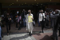 Former Colombian presidential candidate Ingrid Betancourt, who was abducted while campaigning by the Revolutionary Armed Forces of Colombia rebels, leaves Chapinero Theater after participating in an event at the Truth Commission to commemorate victims of the country's decades-long armed conflict, in Bogota, Colombia, Wednesday, June 23, 2021. (AP Photo/Ivan Valencia)