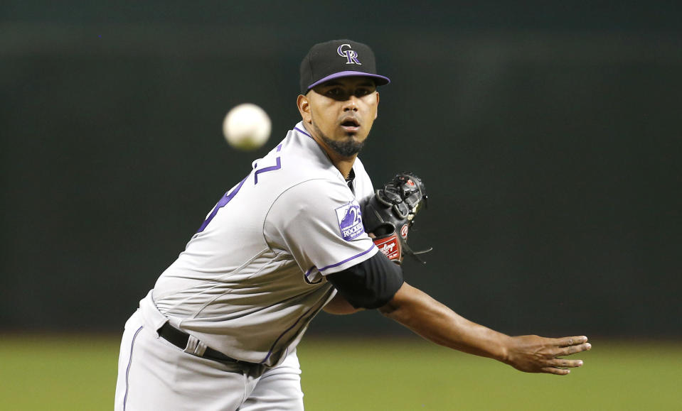 Colorado Rockies pitcher German Marquez throws in the first inning during a baseball game against the Arizona Diamondbacks, Friday, Sept. 21, 2018, in Phoenix. (AP Photo/Rick Scuteri)