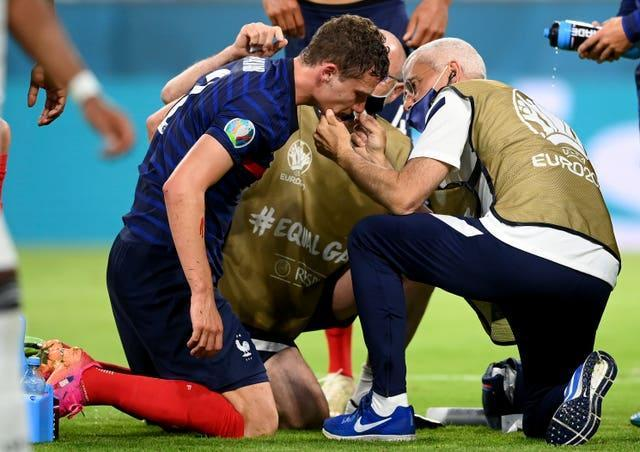 Pavard receives medical attention after his collision