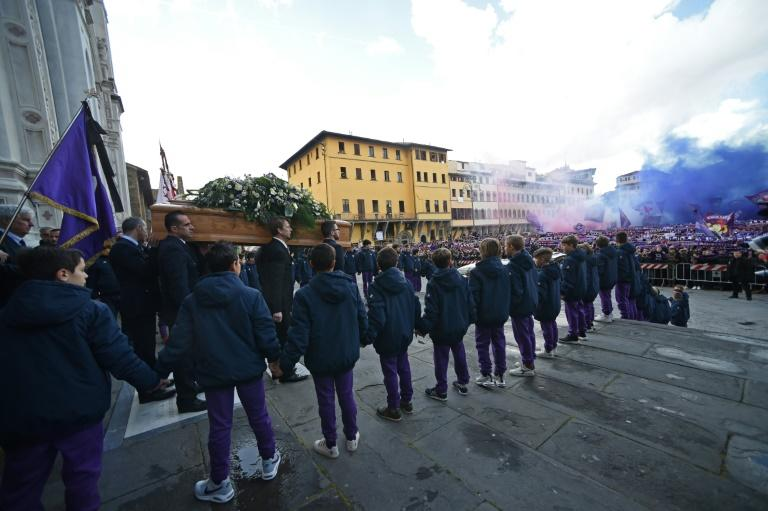 Thousands of Fiorentina supporters let off smoke flares as Davide Astori's coffin was carried out of the Santa Croce basilica in Florence after the club captain's funeral