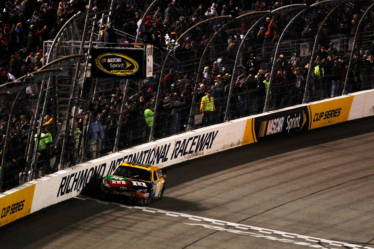 RICHMOND, VA - APRIL 28:  Kyle Busch, driver of the #18 M&M's Ms. Brown Toyota, crosses the finish line to win the NASCAR Sprint Cup Series Capital City 400 at Richmond International Raceway on April 28, 2012 in Richmond, Virginia.  (Photo by Todd Warshaw/Getty Images for NASCAR)