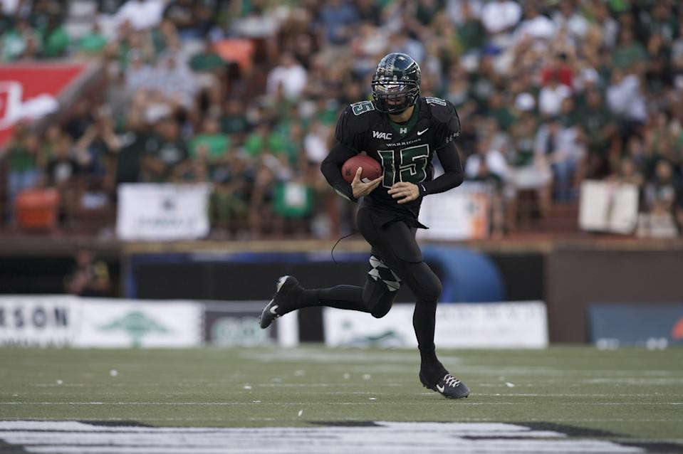 University of Hawaii quarterback Colt Brennan (15) runs the ball during an NCAA football game against the Boise State Broncos at Aloha Stadium. Hawaii defeated Boise State 39-27 to win the 2007 WAC championship. (Photo by Jordan Murph /Icon SMI/Icon Sport Media via Getty Images)