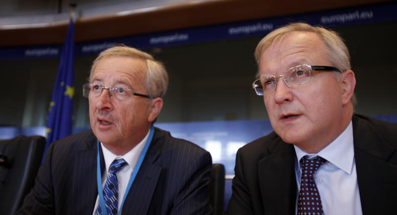 Luxembourg's Prime Minister and head of the eurogroup Jean-Claude Juncker, left, and European Commissioner for Monetary Affairs Olli Rehn prepare for the start of a session at European Parliament in Brussels on Monday, Aug. 29, 2011.  The head of the European Central Bank and other key eurozone officials are set to debate the latest hitches in the currency union's debt crisis with European lawmakers.  (AP Photo/Virginia Mayo)