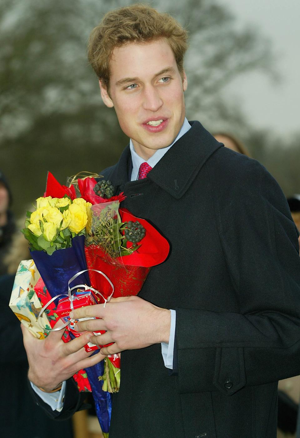 <p>William accepts flowers from a wellwisher as he leaves a Christmas Day service at Sandringham Church December 25, 2002. (Scott Barbour/Getty Images)</p>