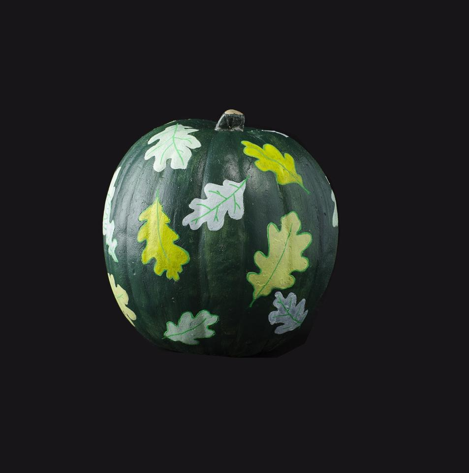 <p><strong>1.</strong> Paint the pumpkin a solid color and allow it to dry completely, or about one hour.</p> <p> <strong>2.</strong> Collect fallen leaves from the backyard and trace the outline of the leaves onto the pumpkin surface using a ballpoint pen.</p> <p> <strong>3.</strong> Fill in the outlines with acrylic paint and let dry. If desired, outline the leaves with a paint pen and draw on veins.</p>