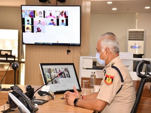 Commissioner of Police SN Shrivastava interacting with COVID-positive personnel.