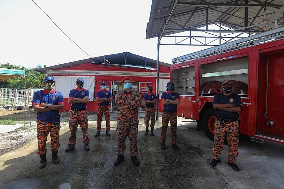 The local volunteer firefighters group — also known as Pasukan Bomba Sukarela — was formed solely to assist local fire departments in handling emergencies. — Picture by Mohd Yusof Mat Isa