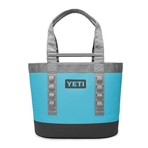 """<p><strong>YETI</strong></p><p>amazon.com</p><p><strong>$205.99</strong></p><p><a href=""""https://www.amazon.com/dp/B07NJ633ZP?tag=syn-yahoo-20&ascsubtag=%5Bartid%7C10055.g.29499968%5Bsrc%7Cyahoo-us"""" rel=""""nofollow noopener"""" target=""""_blank"""" data-ylk=""""slk:Shop Now"""" class=""""link rapid-noclick-resp"""">Shop Now</a></p><p>Toss your adventure gear into this durable beach and boat bag from your favorite cooler brand. It comes in four beautiful colors, and its contents wont get soaked on your next adventure. And if you're looking for a <em>cooler</em>, check out the perfectly-sized <a href=""""https://go.redirectingat.com?id=74968X1596630&url=https%3A%2F%2Fwww.yeti.com%2Fen_US%2Fhard-coolers%2Froadie-24-hard-cooler%2F10022160000.html&sref=https%3A%2F%2Fwww.goodhousekeeping.com%2Fholidays%2Fgift-ideas%2Fg29499968%2Fbest-camping-gift-ideas%2F"""" rel=""""nofollow noopener"""" target=""""_blank"""" data-ylk=""""slk:Roadie 24 Hard Cooler"""" class=""""link rapid-noclick-resp"""">Roadie 24 Hard Cooler</a> that conveniently fits behind the passenger's seat of your car.</p>"""