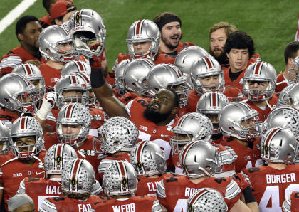 Ohio State Buckeyes defensive lineman Chris Carter (72) holds up his helmet prior to the game against the Oregon Ducks in the 2015 CFP National Championship at AT&T Stadium. (Jerome Miron-USA TODAY Sports)