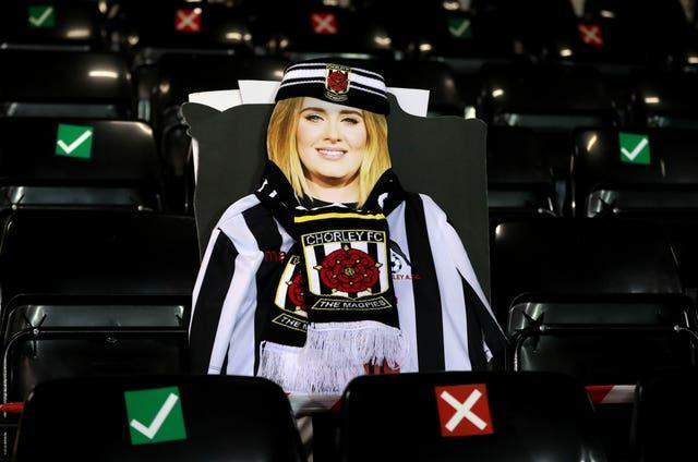 A cardboard cutout of Adele in the stands at Victory Park, Chorley