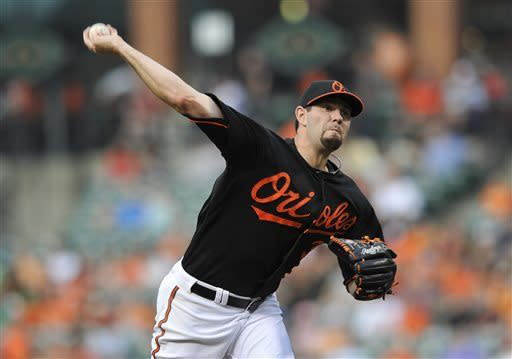 Baltimore Orioles pitcher Jason Hammel delivers against the Tampa Bay Rays in the inning of a baseball game, Friday, May 17, 2013, in Baltimore. (AP Photo/Gail Burton)