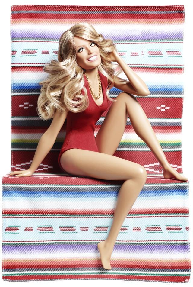 "<div class=""caption-credit""> Photo by: barbiecollector.com</div><b>Farrah Fawcett doll, released in 2011 for $34.95</b> <br> Just like the iconic poster, this mini Farrah comes with her signature red swimsuit and blanket. The doll is stuck posed in this position, smiling forever. <br>"