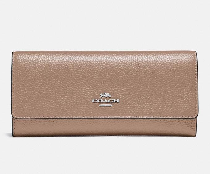 Soft Trifold Wallet. Image via Coach.