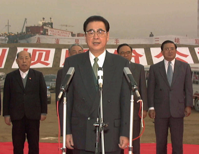 CORRECTS AGE TO 90, INSTEAD OF 91 - FILE - In this Nov. 8, 1997, file photo, released by China's Xinhua News Agency, then Chinese Premier Li Peng, center, gives the order to block one side of China's Yangtze River at Sandouping during a ceremony at the site of the Three Gorges Dam in China's Hubei province. Li Peng, a former hard-line Chinese premier best known for announcing martial law during the 1989 Tiananmen Square pro-democracy protests, has died. He was 90. (Xinhua via AP, File)