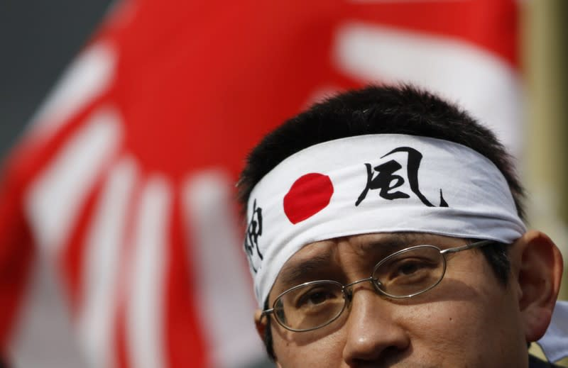 A protester takes part in an anti-South Korea rally near South Korean embassy in Tokyo