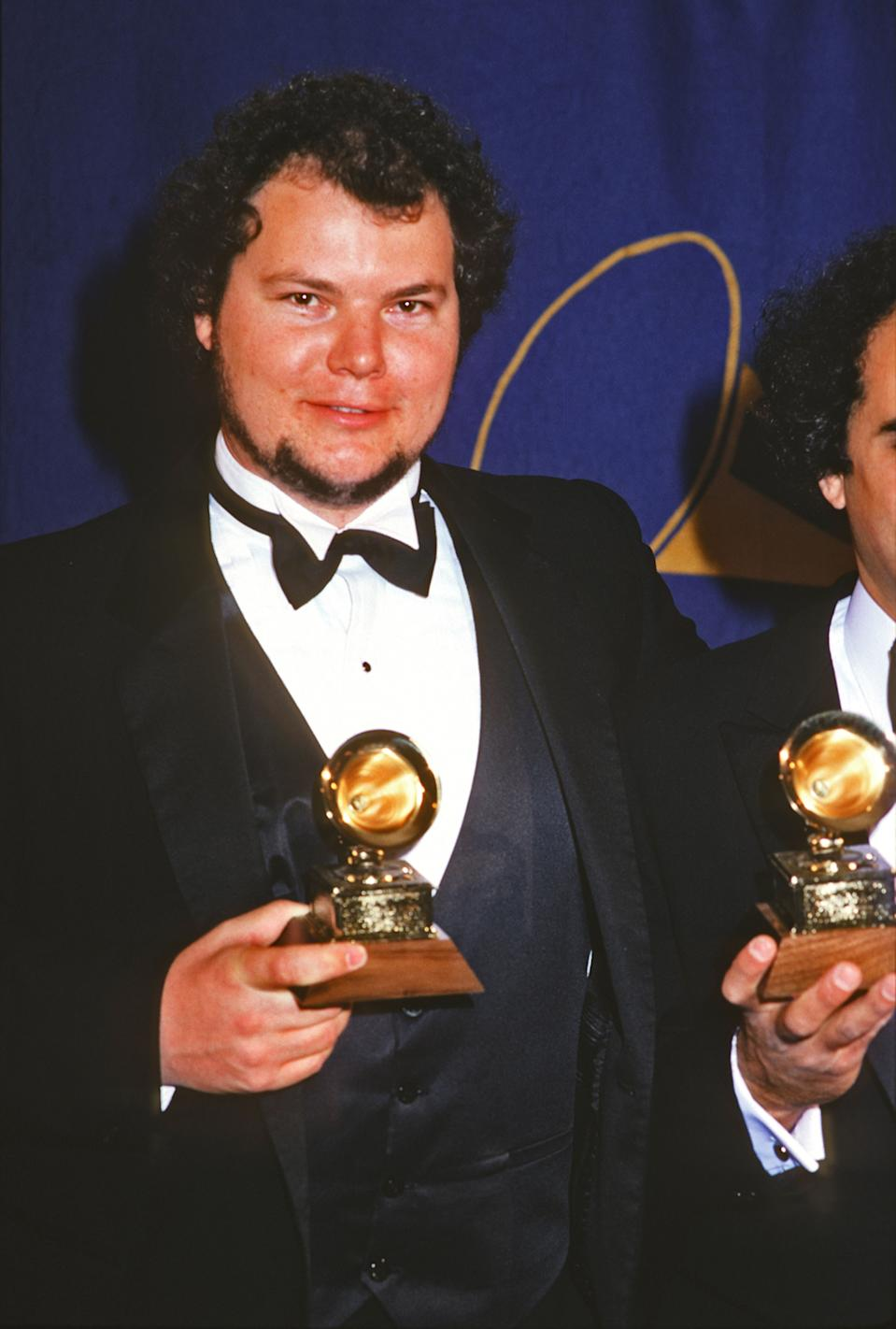 Christopher Cross poses with a Grammy Award (one of several for his song