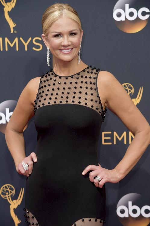 FILE - In this Sept. 18, 2016 file photo, TV personality Nancy O'Dell arrives at the 68th Primetime Emmy Awards in Los Angeles. Court records in Los Angeles obtained Friday, Oct. 14, 2016, show O'Dell filed for legal separation from her husband of 11 years, Keith Zubchevich, on Sept. 19. The filing came three weeks before leaked audio of GOP presidential candidate Donald Trump included him talking about his failed efforts to sleep with O'Dell while she was married. O'Dell has called Trump's remarks sad and disappointing. (Photo by Richard Shotwell/Invision/AP, File)