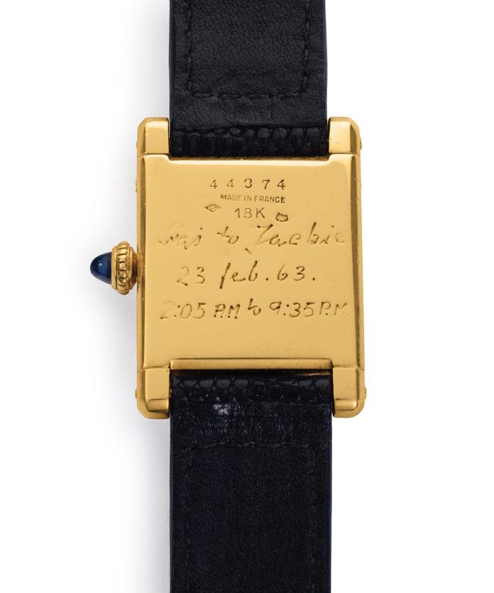 Jackie Kennedy's watch on an auction together with a painting