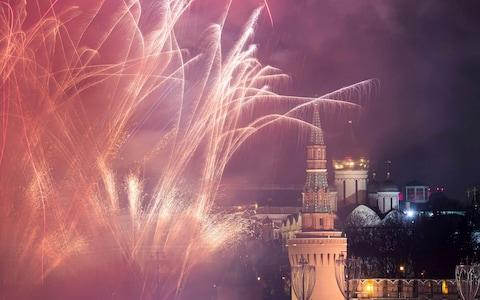<span>Fireworks explode in the sky during New Year's celebrations in Moscow</span> <span>Credit: Reuters </span>