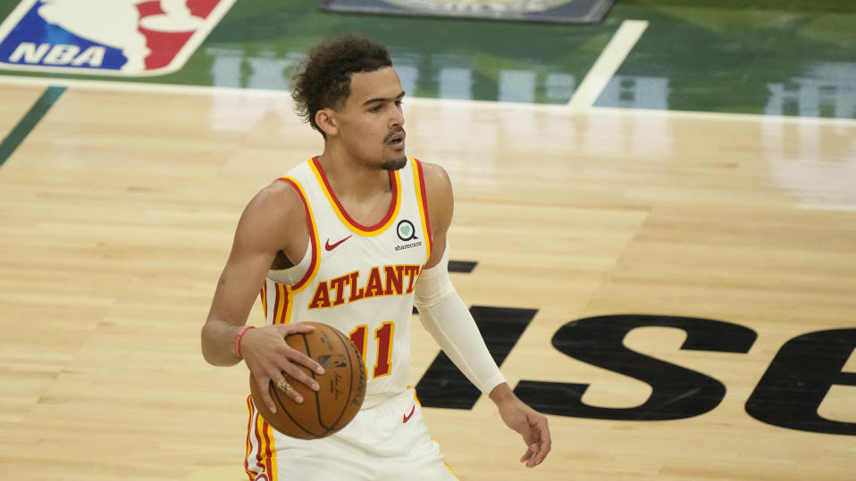 Atlanta Hawks' Trae Young dribbles during the second half of Game 1 of the NBA Eastern Conference basketball finals game against the Milwaukee Bucks Wednesday, June 23, 2021, in Milwaukee. (AP Photo/Morry Gash)