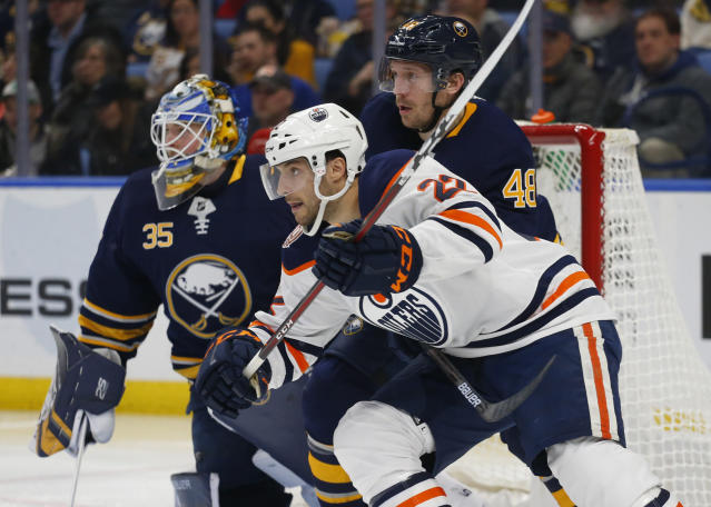 CORRECTS TO OILERS FORWARD TOBIAS RIEDER NOT OILERS FORWARD DARNELL NURSE - Buffalo Sabres defenseman Matt Hunwick (48) and Edmonton Oilers forward Tobias Rieder (22) battle for position during the second period of an NHL hockey game, Monday, March 4, 2019, in Buffalo N.Y. (AP Photo/Jeffrey T. Barnes)