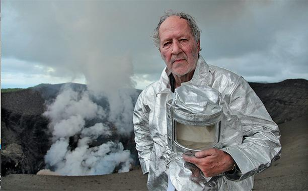 """Renowned auteur Werner Herzog explores the fiery depths of Earthin the explosivenew trailer for his forthcoming documentary,Into the Inferno.  The just-releasedclip, set to anominoussynth-driven score, teases footage captured on the international journey taken byHerzog andvolcanologist Clive Oppenheimer, duringwhich they explored some of the world's most active volcanic sitesfrom Antarctica and Ethiopia to Iceland and North Korea.  """"The sun dimmeth, the land sinketh, gushethforth steam and gutting fire. To the heavens soared the hurtling flames of the mighty gods;the engulfing doom,"""" Herzog narrates.""""It is hard to take your eyes off the fire that burns deep under our feet. Obviously there was a scientific side to our journey, but what we were really chasing was the magical side, no matter how strange things might eventually get. It is a fire that wants to burst forth, and it could not care less about what we are doing up here.""""  In addition tostunning visuals of the globe's fiercest volcanic sites, the film promises a deep dive into various cultures'philosophies surrounding the fiery natural wonders, while also examining the psychology ofhuman fragility in the face of nature's fury, as one interview subject muses on the idea that a volcano will one day """"destroy this world.""""       In September,Into the Infernohad its world premiere at the Telluride Film Festival. It later traveledto both the Toronto International Film Festival and the Rome Film Festival,where it receivedpositive reviews from movie critics.  Into the Infernowill screen ata limited number of theaters in New York and Los Angeles on Oct. 28, the same day it hits Netflix. Watch the film's new trailer above, and check out its poster below.        Image Credit: Netflix     frameborder=""""0"""" allowFullScreen>"""