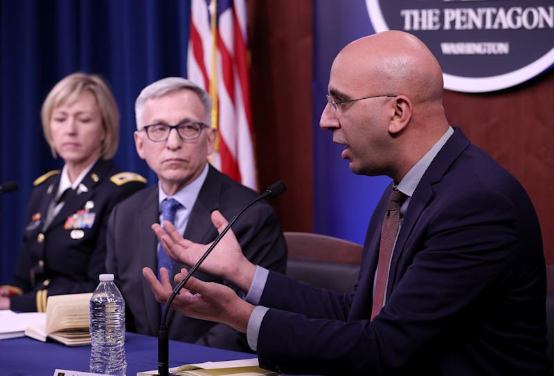 Dr. Kayvon Modjarrad (R), director of Emerging Infectious Diseases at the Walter Reed Army Institute of Research, joins members of a panel at the Pentagon in discussing efforts at investigating and developing vaccine candidates against COVID-19 March 05, 2020 in Arlington, Virginia. Also pictured are Dr. Nelson Michael M.D. (C), Director of the Center for Infectious Disease Research, and Col. Wendy Sammons-Jackson (L), Medical Service Corps. (Win McNamee/Getty Images)