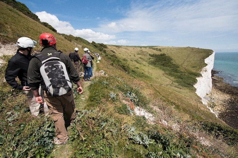 Visitors walk on the cliff-top paths above the Fan Bay Deep Shelter, overlooking Dover, England, on July 23, 2015