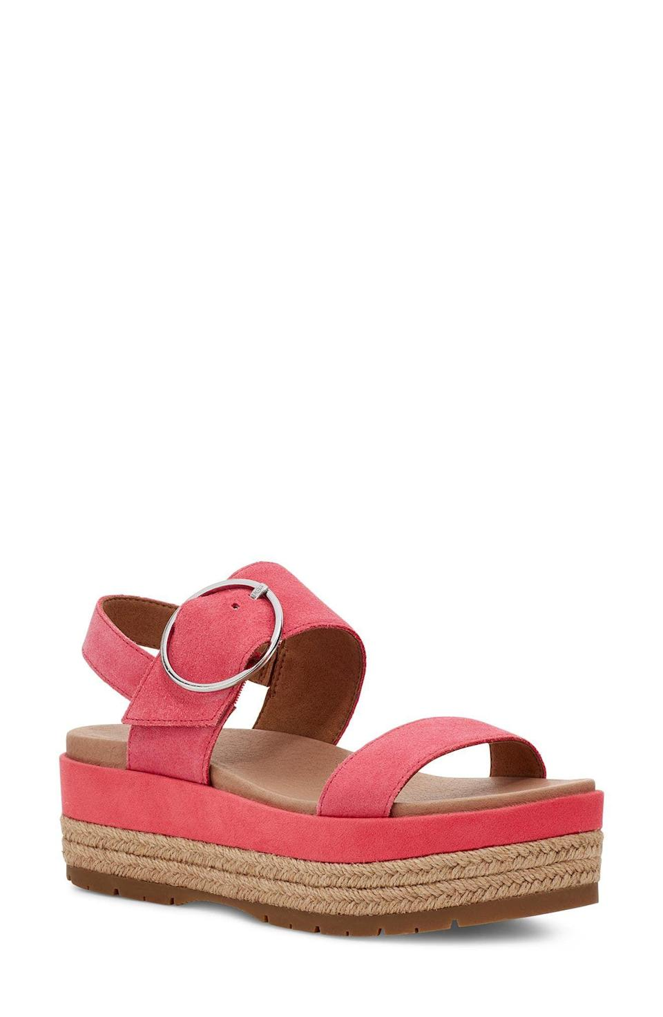 """<p><strong>UGG</strong></p><p>nordstrom.com</p><p><strong>$130.00</strong></p><p><a href=""""https://go.redirectingat.com?id=74968X1596630&url=https%3A%2F%2Fwww.nordstrom.com%2Fs%2Fugg-april-espadrille-platform-sandal-women%2F5806562&sref=https%3A%2F%2Fwww.oprahdaily.com%2Fstyle%2Fg25893553%2Fbest-sandals-for-women%2F"""" rel=""""nofollow noopener"""" target=""""_blank"""" data-ylk=""""slk:SHOP NOW"""" class=""""link rapid-noclick-resp"""">SHOP NOW</a></p><p>Made from premium leather, this platform espadrille adds a couple inches while still being comfortable—thanks to the memory foam lining and rubber soles.</p>"""