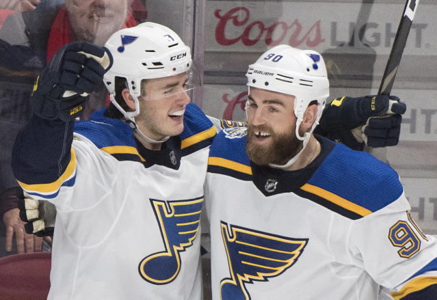 St. Louis Blues' Sammy Blais (9) celebrates with teammate Ryan O'Reilly (90) after scoring during second period NHL hockey action against the Montreal Canadiens, in Montreal, Saturday, Oct. 12, 2019. (Graham Hughes/The Canadian Press via AP)