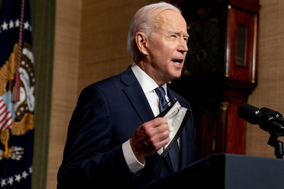 President Joe Biden removes his mask to speak from the Treaty Room in the White House on Wednesday, April 14, 2021, about the withdrawal of the remainder of U.S. troops from Afghanistan.