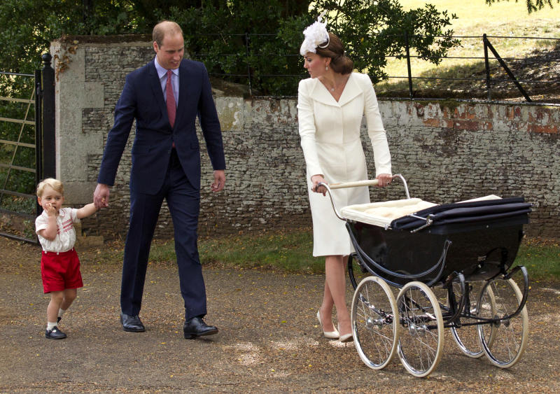 Catherine, Duchess of Cambridge, Prince William, Duke of Cambridge, Princess Charlotte of Cambridge and Prince George of Cambridge leave the Church of St Mary Magdalene on the Sandringham Estate after the Christening of Princess Charlotte of Cambridge on July 5, 2015